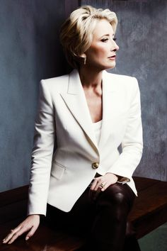 Emma Thompson in white jacket and black leather pants