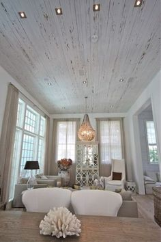 Distressed white wood plank ceiling