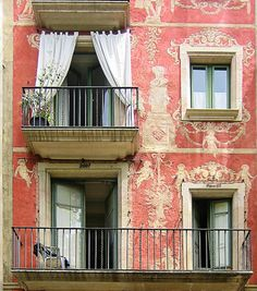 Ohhh how I love the color and details on this building in Barcelona, Spain. The drapes on the terrace are delightful.