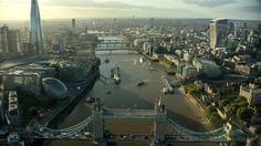 Aerial footage shot from an AS355 helicopter over London in 4k. Showing the City of London, the Shard, River Thames, More London, View from the Shard, Leadenhall Building, London Bridge and commuters, St Paul's Cathedral, Palace of Westminster, Nine Elms, London Eye, London. Music by Jack Cook