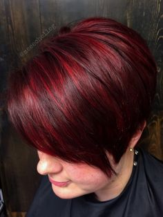 bright red, red highlights, stand out red, candy apple red, short hair, pixie, bold red, vivid, growing out pixie, angled, fun, sassy
