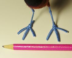 1. Here are the wire feet of my felted Northern Jacana (and a pencil for scale). So far, I've wrapped the feet in blue embroidery floss (and they look pretty good, if I say so myself), but they are in dire need of a jacana's long, pointed claws.