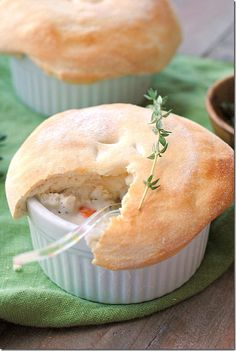 Skinny Chicken Pot Pies    1 cup fat-free half and half  1 cup fat-free chicken broth  3 Tbsp. all-purpose flour  1 tsp. poultry seasoning  1 tsp. thyme  2 cups roasted skinless chicken breast, cubed  1 (10 oz) package frozen mixed veggies, thawed  4 green onions, chopped  1 tsp. salt  1/4 tsp. pepper  1 can (7.5 oz) refrigerated reduced-fat biscuits