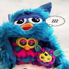 A furby boom mother with his Furbling on a, what's that?