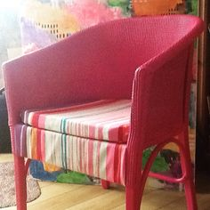 A Lloyd Loom style chair painted with satinwood carefully.  A pieces of foam from Dunelm and covered with Scion fabric.  Jobs a good one,