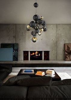 Industrial-Living-Room-with-Concrete-Wall-and-Accent-Black-Sectional-Sofa-Decorated-with-Stylish-Bulb-Chandelier.jpg 600×850 piksel