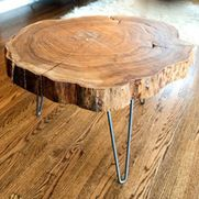 Natural Live-Edge Round Slab Side Table/Coffee Table by Norsk Valley Workshop - I love this rustic and modern coffee table fashioned from a slab of wood.