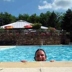 Swimming Pool And Slide At Domaine Laborde Naturist Resort On The Borders Of The Dordogne And