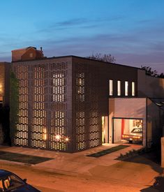 Once a horse stable, this Chicago house first got a superficial makeover from Oprah (we wonder whether Stedman likes modern) before architect Jeanne Gang of Studio Gang was called in for a more substantial renovation and a dazzlingly porous brick screen.  Photo by Gregg Segal.