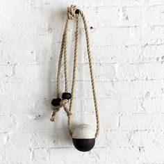 "Single stoneware Black & White bead garland assembled on 10mm hemp rope and with 2 paring beads  Measures approximately 22 long"" hanging, bead measures 3.5"" x 4"" Handmade & assembled in NYC Thank you!   Available for IMMEDIATE DELIVERY"