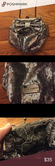 Betsey Johnson Sequin Sparkle Small Purse Very cute purse from Betsey Johnson! Small and sparkly. It's 6 by 4, pretty deep. Can fit my iPhone 6 along with a few other things. The entire chain length is 17 inches. Used a handful of times and has just been hanging in my closet. (Note: there is no stain on the outside logo; that is just a glare or reflection.) Betsey Johnson Bags