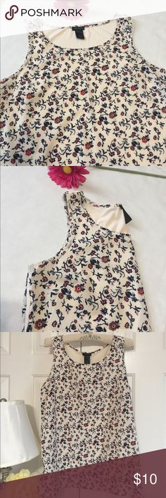 Ann Taylor Floral Top Floral sleeveless top from Ann Taylor. Contrast materials in one top. Front is silky Polyester and back is knit cotton. Side vents. Great condition. Ann Taylor Tops