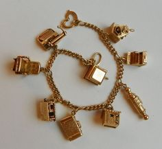 14K Gold Charm Bracelet - has $1800 in Moveable Charms..