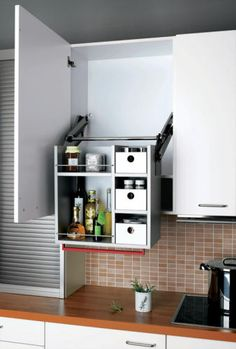 cabinet universal design. wonderful lowering cabinet. when shut it looks totally normal, but anyone can reach it with much more ease.