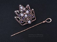 This is a 2in1 jewelry. You can use it as a hair pin for any type of hair or as a brooch for your knitted clothes or scarves. Crown hair pin made from copper with multi-colored gems and pearls. It is a good idea of gift for girl or woman for Halloween or Cosplay. The crown is very comfortable. I recommend pre-fixing the hair with an elastic band of your hair color. Size of the crown is 7,3 x 7,1 cm (2.9x2.8). Length of pin is 12,6 cm (4.7).  Jewelry is patinated, polished and covered with…