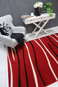 Runiullae Modern Drop Stripes Red Rug A marvelous exhibit of trendsetting rugs, this Collection instills life into extraordinary spaces. Expertly power-loomed in Turkey, these rugs are easy-care and virtually non-shedding. Classic designs become fashion-smart home decor in this alluring and playful collection.