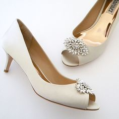 "Badgley Mischka Nakita. Low heel peep-toe pumps with a low cut side for some added ""sex-appeal"""
