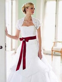 A wedding bolero jacket.  (If you found something sleeveless, there are many different styles of these.)  Is that something you'd consider?