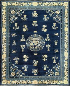 Antique Chinese Rug from the 1900s. Made in navy from wool and hand-knotted details, completed with floral details.