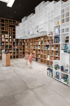 Shelving covers walls of SoNo Arhitekti's Book Centre Trieste