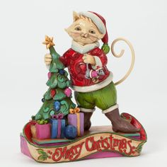 Title: Christmas Cat-itude Introduction: January 2014 Item Number: 4041096 Material: Stone Resin Dimensions: 5.25in H x 2.375in W x 4.875in L Weight: 1.15 lb Figurine Jim Shores whimsical Christmas ca