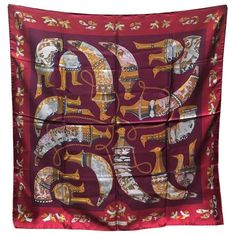 Hermes Vintage Rhytons Silk Scarf in Burgundy   From a collection of rare vintage scarves at https://www.1stdibs.com/fashion/accessories/scarves/