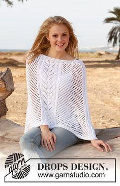 "Knitted DROPS poncho with cables and lace pattern in ""Paris"". Size: S - XXXL. ~ DROPS Design"