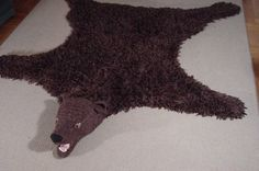 Bear skin rug in the foyer- get a step-pad that will trigger a growl when people walk over it. Check the price of faux-fur vs. buying one at IKEA.