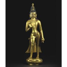 Mongolia, 17th-18th century, gilt copper alloy and pigment, private collection. Apart from the usual stupa, this one also has a flaming jewel on top of his head