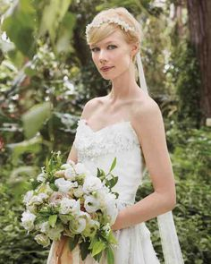 Erin, dressed in a gown of her own designs and Jimmy Choo shoes, carried a bouquet of peonies, sahara and majolica spray roses, parrot tulips, and jasmine.