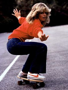 in those new orange swoosh sneakers, feathered back hair- Farrah Fawcett on a skate board.