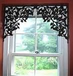 Shelf brackets repurposed to frame a window