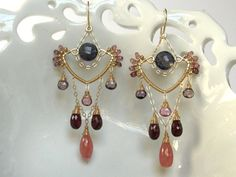 Handmade Wire Wrapped Earrings Art Deco Style by AdornobyHolly  I love this artist's work . . . She is truly the master of shape and movement.