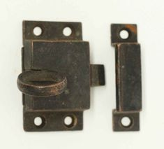Antique simple bronze ring pull cabinet latch with matching keeper. Priced each.