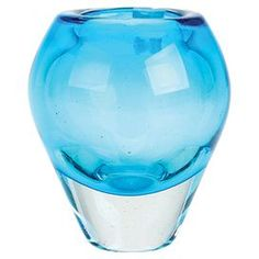Aqua glass vase with a fjord-inspired silhouette.  Product: VaseConstruction Material: GlassColor: AquaFeatures: Hand-blown Cleaning and Care: Wipe with a  damp cloth