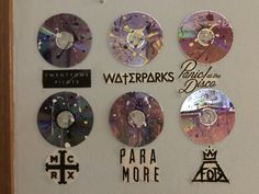 I just took some plain Cds and splattered them with paint and added some band names under them.