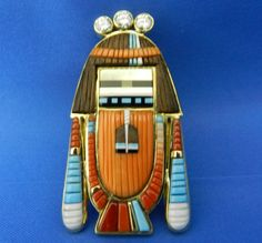 "Jesse Monongya, Hopi/Navajo, mosaic pendant, Longhair Katsina. For the artist biography, see ""American Indian Jewelry III,"" by Gregory and Angie Schaaf"