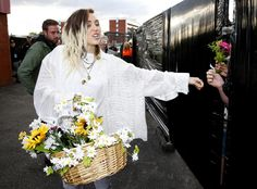 MANCHESTER, ENGLAND - JUNE 04:  Miley Cyrus hands out flowers to fans during the One Love Manchester concert at Old Trafford Cricket Ground Cricket Club on June 4, 2017 in Manchester, England.  (Photo by Matthew McNulty/Getty Images) via @AOL_Lifestyle Read more: https://www.aol.com/article/entertainment/2017/06/05/one-love-manchester-miley-justin-behind-the-scenes/22126699/?a_dgi=aolshare_pinterest#fullscreen
