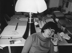 Gae Aulenti in frony of the Pipistrello lamp she designed in 1965 for Martinelli Luce