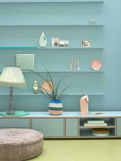 Styling: Marianne Luning   Photographer: Tjitske van Leeuwen vtwonen september 2012 #vtwonen #magazine #interior #bookshelves #pastel #blue #pouf