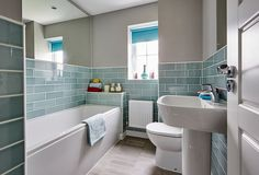 An impressive show home beautifully decorated by interior designers. The hub of this home is sure to be the open plan fitted kitchen and dining area featuring Family Bathroom, Small Bathroom, Bathroom Ideas, Bathrooms, Barratt Homes, Log Home Kitchens, Other Rooms, Log Homes, Corner Bathtub