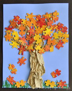 Cute autumn tree made from painted puzzle pieces and crumpled paper bag.  Another option:  paint puzzle pieces diff kinds of green, glue red pom poms for apples, onto lid of a shoe box. Create apple tree art. <- Great for puzzles missing pieces..