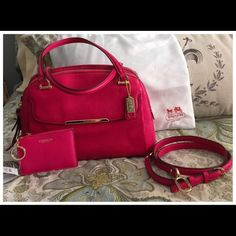 """💕NWOT, Coach Madison Satchel in Pink Ruby💕 New without tags, Coach Madison Satchel in the luscious Pink Ruby shade of tumbled leather! Two separate zippered compartments with plenty of room to stow all of your essentials! There is also an outside magnetic flap to keep your phone, keys, or ID/Passport handy when traveling.  Detachable long strap.💕 This is a beautiful bag in mint condition, never taken out if its dust bag, which is also included!! 12x5x9t. 6"""" & 22 """" strap drop Coach Bags…"""