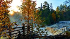 http://fineartamerica.com/featured/sunrise-tahquamenon-waterfall-michael-rucker.html