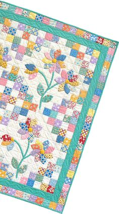 oppsie daisy - perfect for those 30's fabs :)Applique blocks set on point, granny squares as alternate blocks