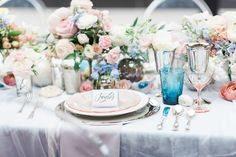 This pastel-hued table, designed by Bright & Co. and captured by B. Jones Photography, takes its cue from Pantone's Colors of the Year for 2016, Rose Quartz and Serenity.  Via The Perfect Palette.