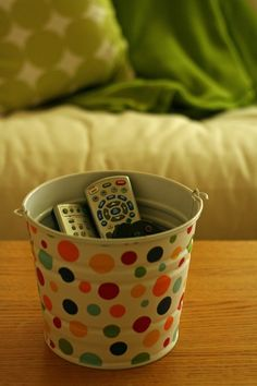 Organizing tip: use metal bucket to hold remotes and game controllers to de-clutter your living space