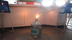 """The Whoosh Bottle is a classic classroom science demonstration of the energy released during combustion. A small volume of alcohol (ethanol, methanol, propanol) is poured into a polycarbonate bottle, which is then sealed to contain the vaporizing liquid. After a short wait, the stopper is removed and a flame placed near the opening to ignite the alcohol fumes. The name """"Whoosh Bottle"""" comes from the roaring sound produced as the flame works its way through the bottle consuming all ..."""