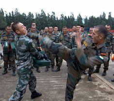 Indian and Chinese Soldiers train in unarmed combat during Joint Exercise Hand-in-Hand 2015 [670x592]