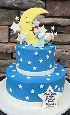 Very sweet lullaby and goodnight baby shower cake with sculpted baby and cut-out fondant stars and moon